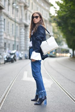 fashion-2015-09-fall-2015-denim-street-style-milan-fashion-week-frayed-hem-ankle-booties-main