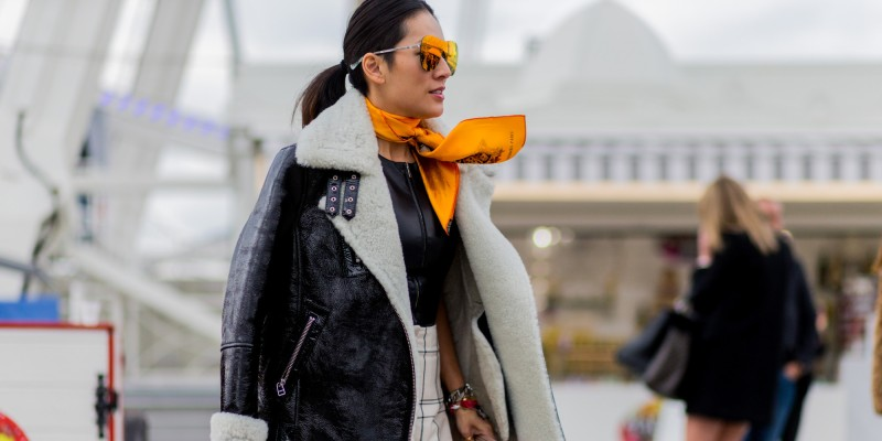 PARIS, FRANCE - MARCH 08: Tina Leung is wearing a black shearling fur leather jacket and an orange scarf outside Valentino during the Paris Fashion Week Womenswear Fall/Winter 2016/2017 on March 8, 2016 in Paris, France. (Photo by Christian Vierig/Getty Images)